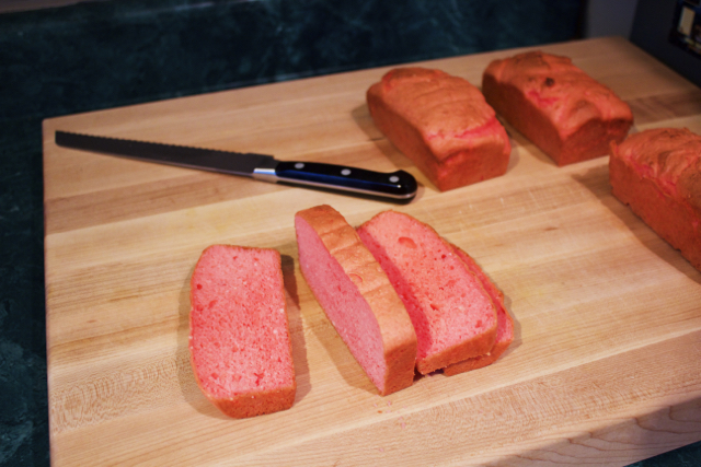 Image of sliced pink cake