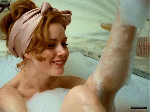 girl smiling in bathtub